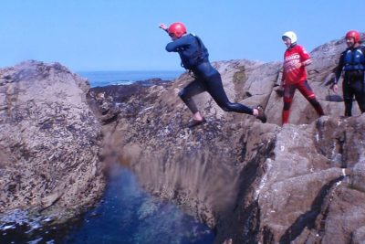 people coasteering