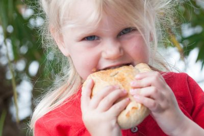 girl eating pasty