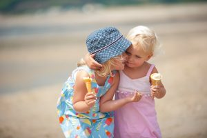 two little girls eating ice cream