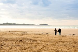 couple walking at Watergate Bay