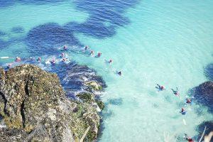 coasteering in clear sea