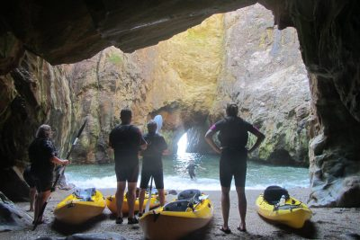 kayakers in cave