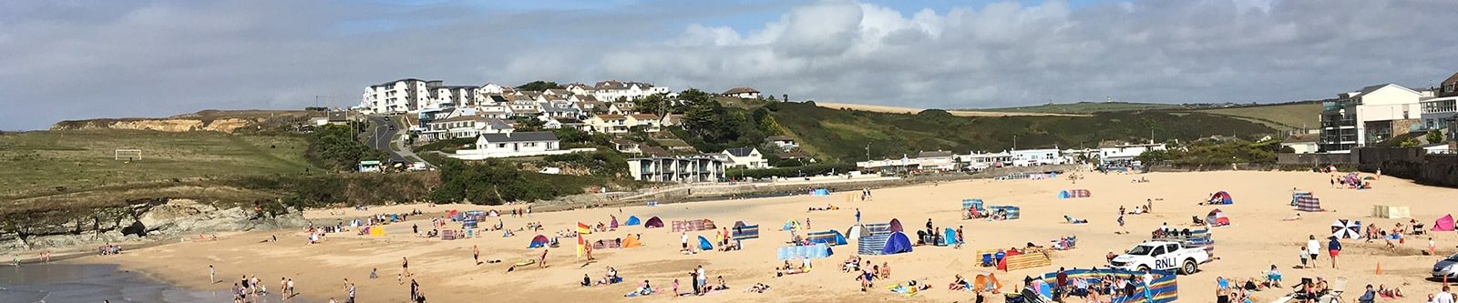 busy Porth beach in summer