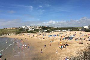 busy Porth beach in summer