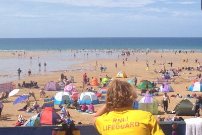 lifeguard watching watergate bay beach