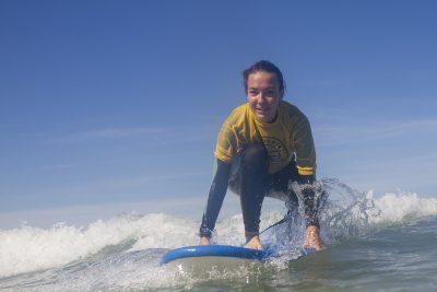 girl kneeling on surf board