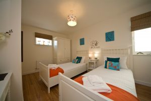 twin bed in beach house apartment 8