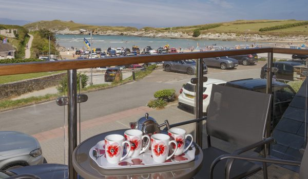 Table set with refreshments overlooking Porth Beach
