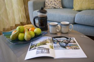 Fruit bowl, cafetiere and magazine on coffee table